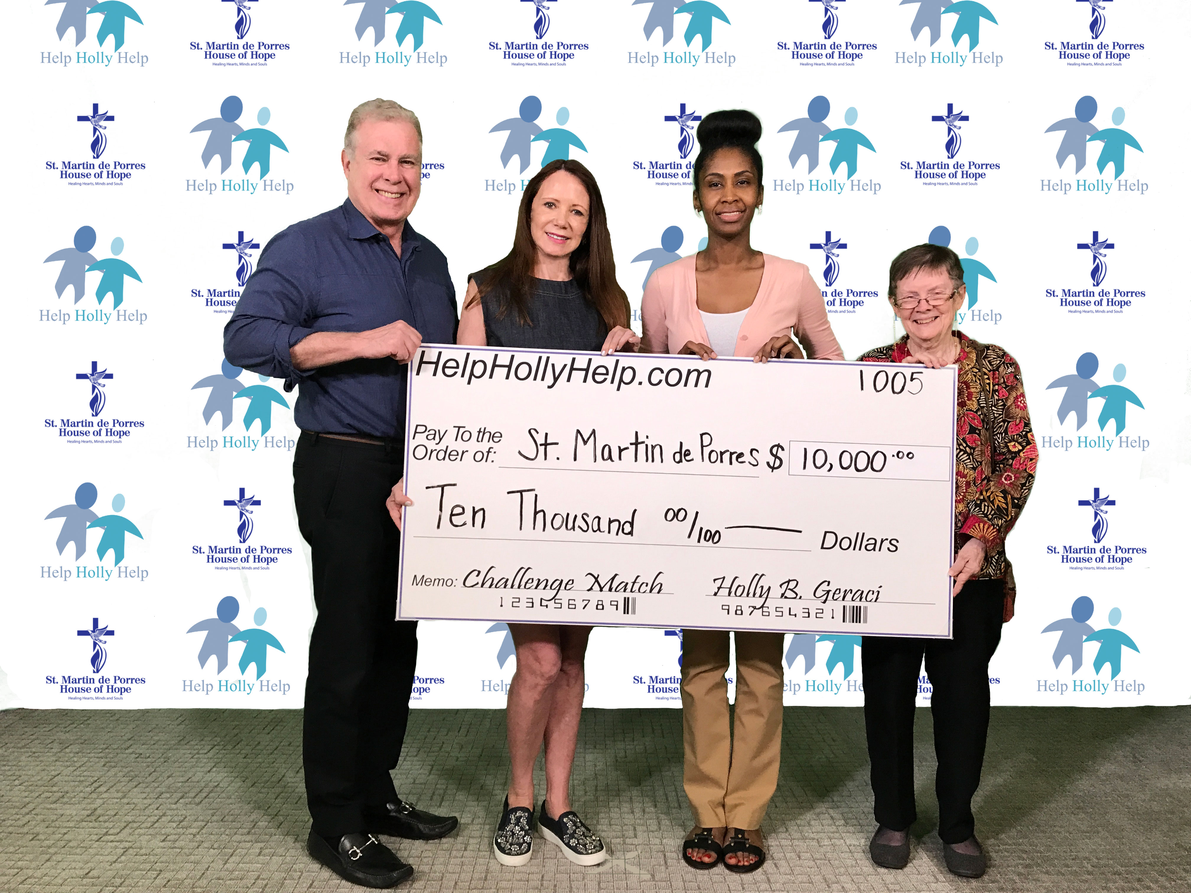 Photo of Holly Geraci & Peter Francis Geraci donating to St. Martin